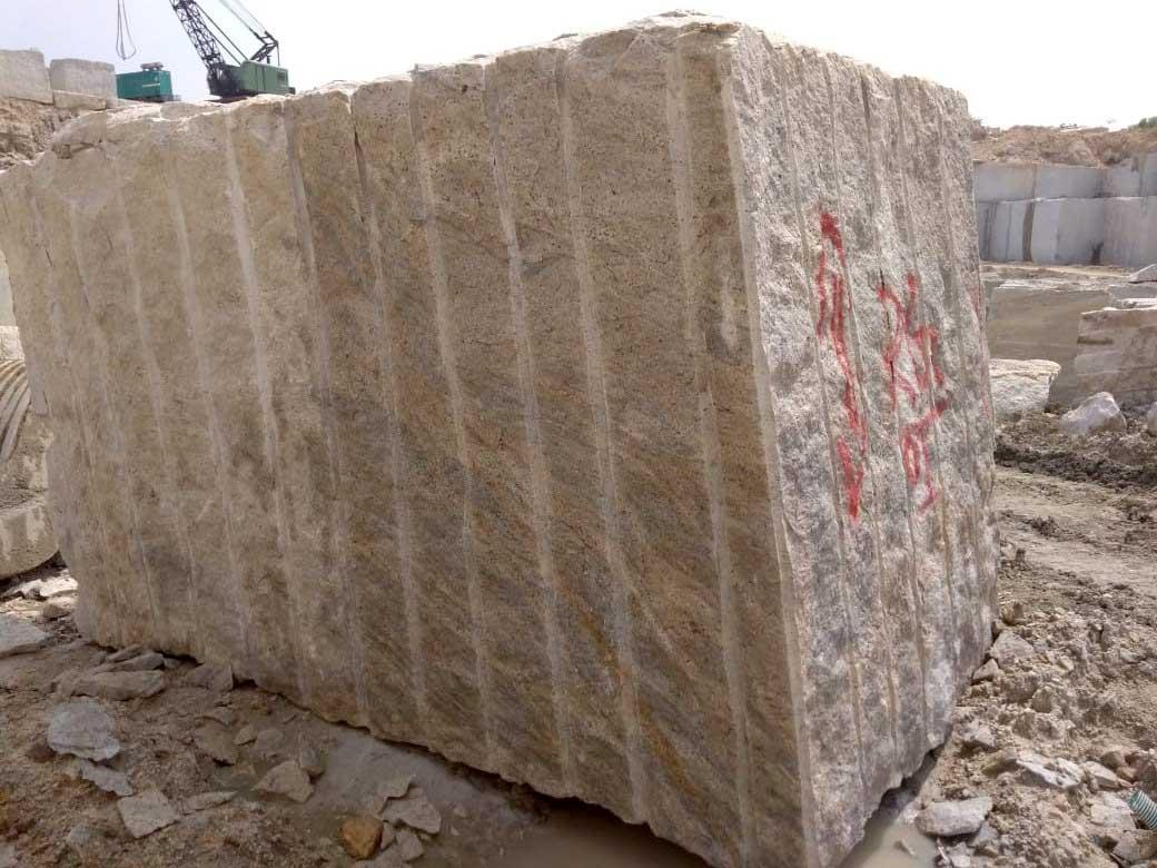 ivory white granite block in quarry