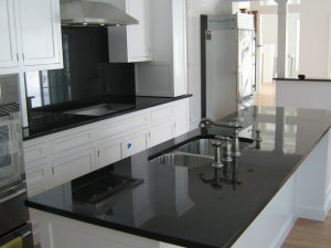 Absolute Black granite countertop with white cabinets