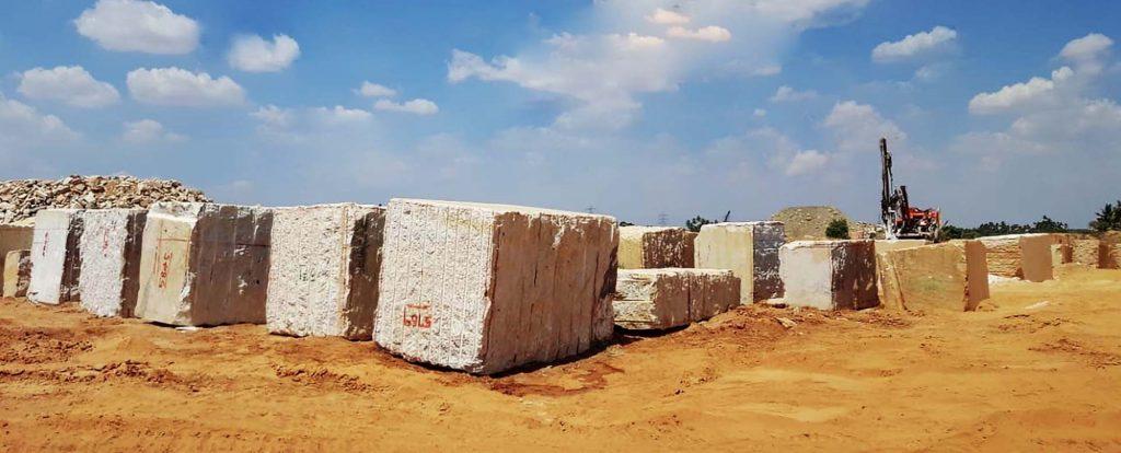 Rough colonial white granite block